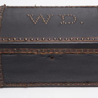 Small black leather trunk